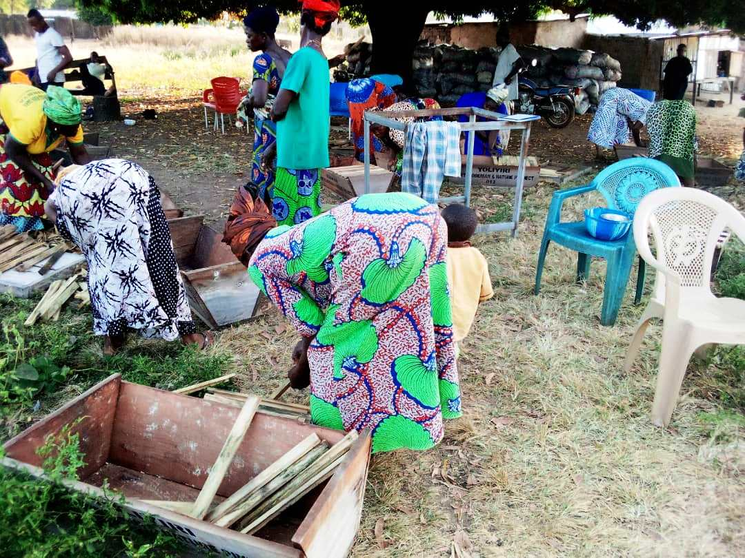 Women eagerly participate in beekeeping training sessions despite their daily work loads (or maybe as a break from them ;-).